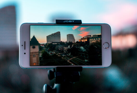 White smartphone making avideo of cities with buildings