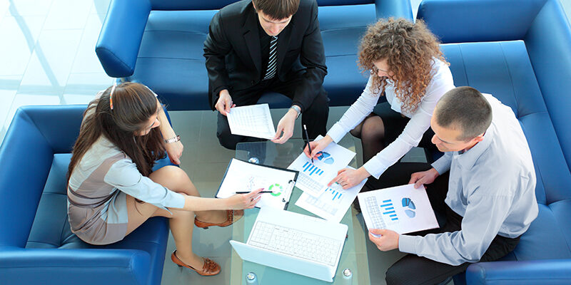 A group of four business people having a meeting