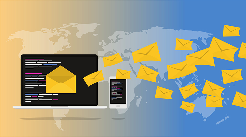 yellow mail envelopes flying from the laptop screen
