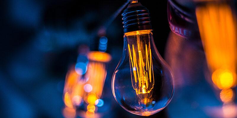 light bulb in a dim blue background