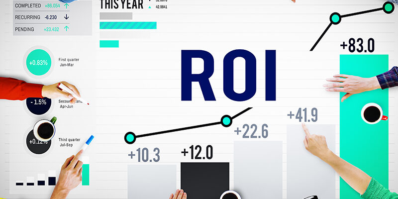 group of people having a meeting with word ROI on their table