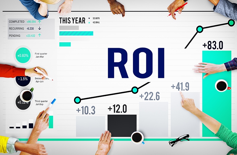 group of people having a meeting with ROI on the table