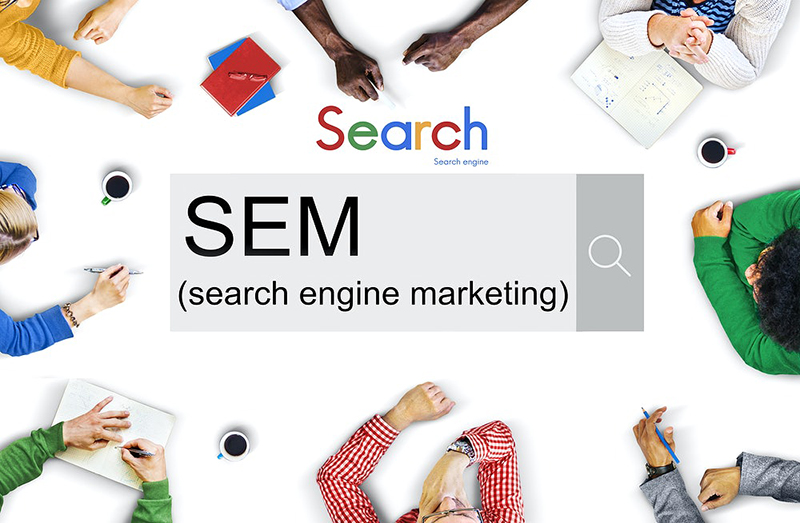 search engine marketing concept on a white table surrounded by people