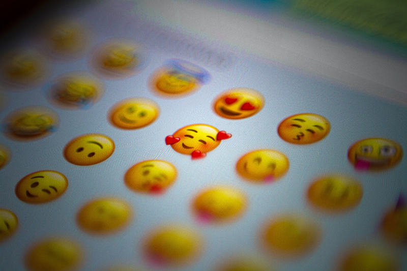 photo of smartphone screen with emoji/emoticons